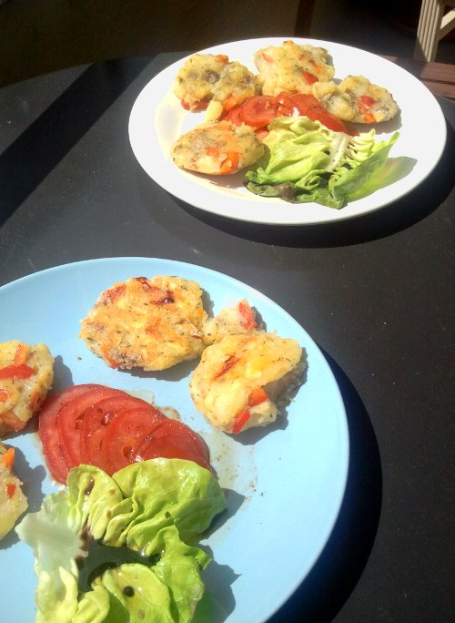 Potato and red pepper cakes with salad